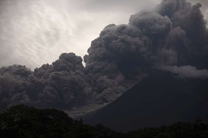 Volcan de Fuego, or Volcano of Fire, blows outs a thick