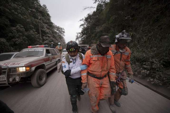 India Tv - Firefighters leave the evacuation area near Volcan de Fuego, or Volcano of Fire, in El Rodeo, Guatemala on Sunday