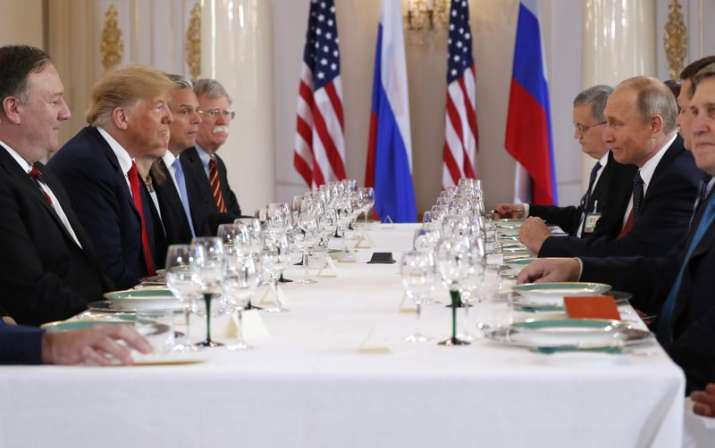 India Tv - US President Donald Trump, second from left, and Russian President Vladimir Putin, second from right, wait for the beginning of a working lunch at the Presidential Palace in Helsinki, Finland