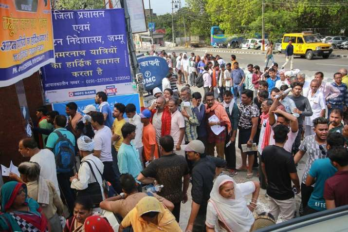 Pilgrims wait in a queue to get themselves registered for