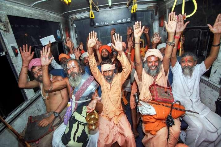 Sadhus chant religious slogans as they resume their