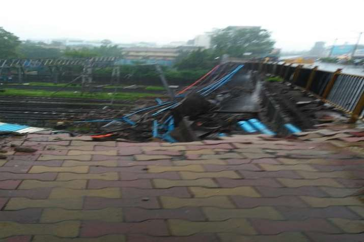 India Tv - Local train services have been affected due to the bridge collapse at Andheri station.
