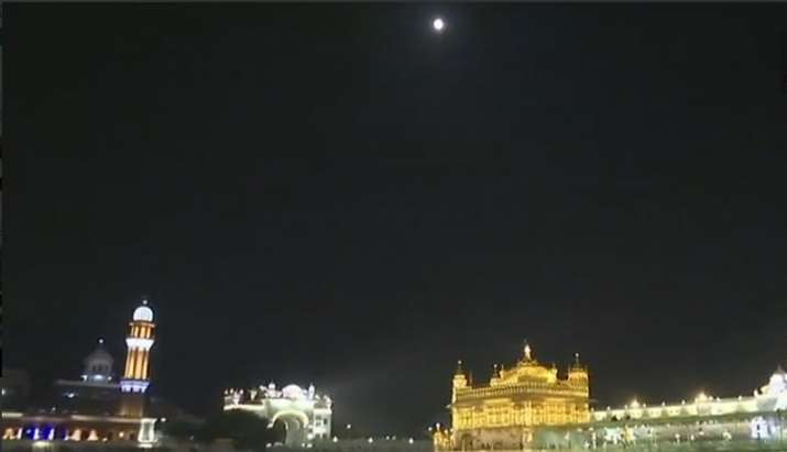 India Tv -   Visual of moon before lunar eclipse from Amritsar's Golden temple