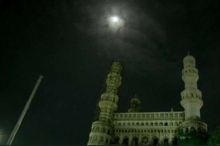 India Tv - Visual of moon before lunar eclipse from Hyderabad's Chaar Minar.