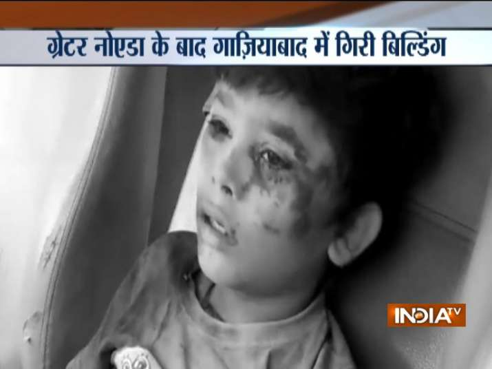 India Tv - The child, who was playing near the consruction site, was rescued after the under construction building collapsed in Ghaziabad's Missal Gadi today.