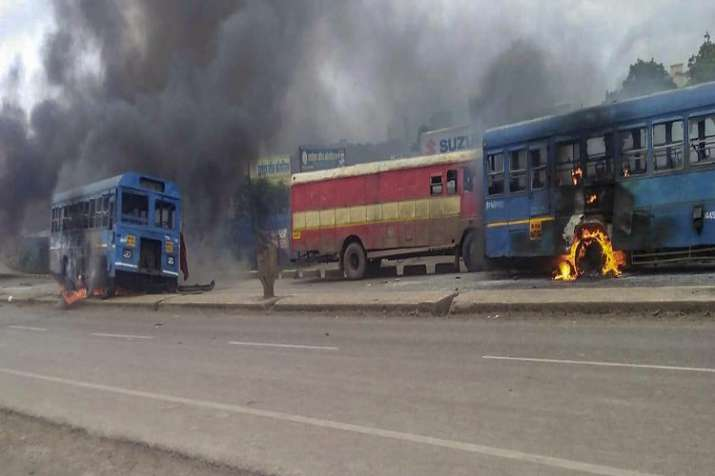 India Tv - Maratha Kranti Morcha activists set ablaze buses during their district bandh called for reservations in jobs and education, in Solapur, Maharashtra on Monday.