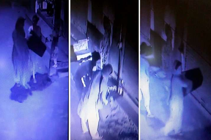 India Tv - In a screengrab from a CCTV camera with a view of the entrance of the Chundawat house is seen members of the family carrying stools , later used in mass hanging which rendered 11 members dead, at Burari area in New Delhi on Wednesday.