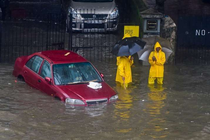 India Tv - A car stuck on a flooded road at King Circle after heavy downpour, in Mumbai on Tuesday.