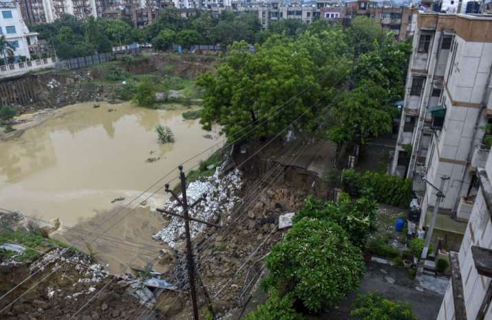India Tv - Ghaziabad: A road caves in after monsoon rainfall at Vasundhara