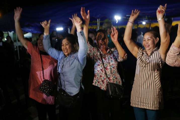 India Tv -     People celebrate after evacuation in Chiang Rai as divers evacuated some of the 12 boys and their coach trapped at Tham Luang cave in the Mae Sai district of Chiang Rai province, northern Thailand.
