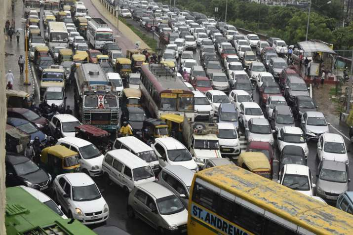 India Tv - Several commuters faced miles-long traffic jams due to heavy rains in Delhi NCR today