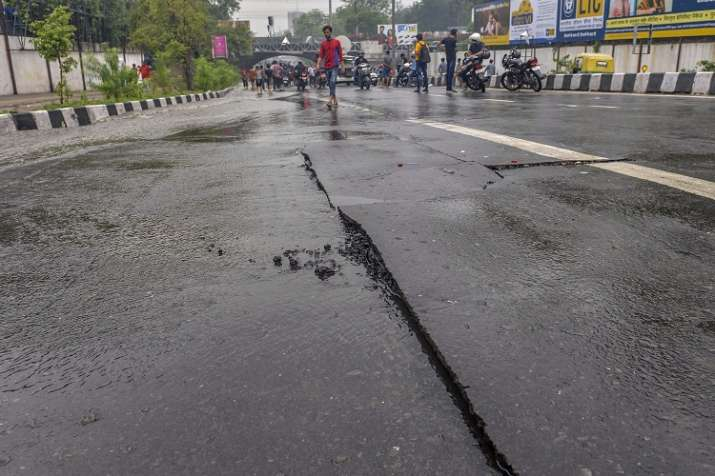 India Tv - A fissure created on a road near Minto bridge after heavy monsoon rain, in New Delhi, on Monday.