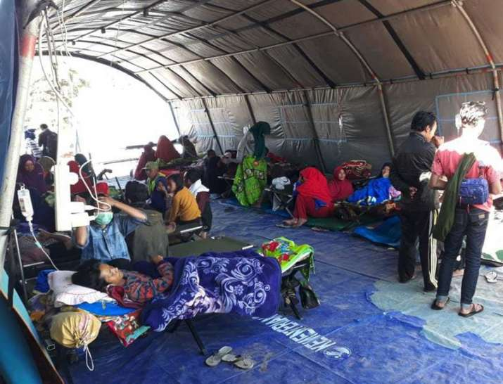 India Tv - Earthquake survivors receive medical treatment at a temporary shelter in Sembalun, East Lombok, Indonesia, Monday, July 30, 2018.