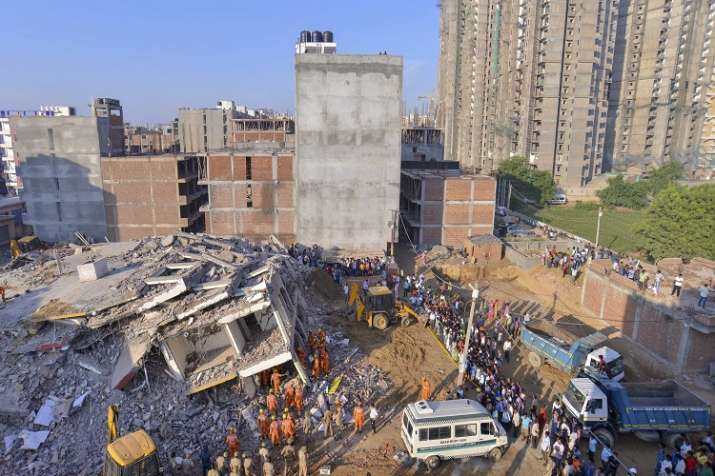 India Tv - At least six people including an year-old infant, were killed and several feared trapped under the rubble of two adjacent buildings which collapsed in Greater Noida on the outskirts of the national capital.