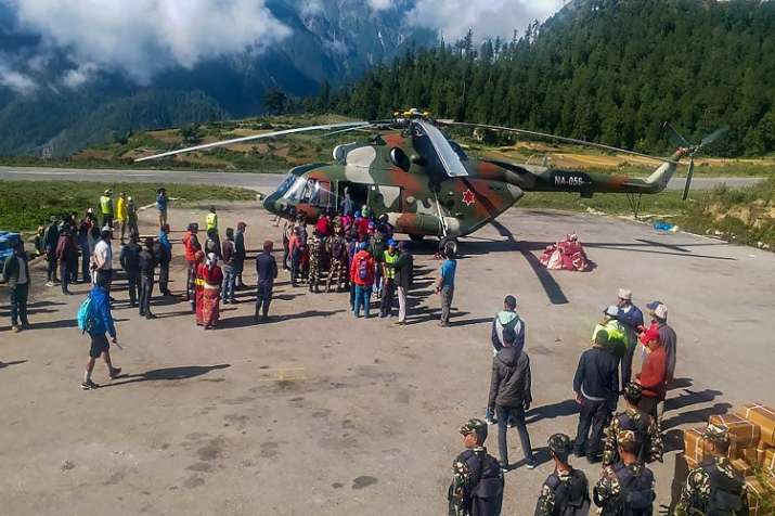 India Tv - Indian pilgrims being evacuated from Simikot to Surkhet and Nepalganj, as authorities stepped up efforts to rescue those stranded there due to heavy rain while returning from the Kailash Mansarovar pilgrimage in Tibet in Simikot on Wednesday.