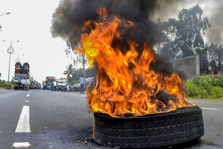 India Tv - Maratha Kranti Morcha activists burn a tyre to stop traffic during their district bandh called for reservations in jobs and education, in Solapur, Maharashtra on Monday.