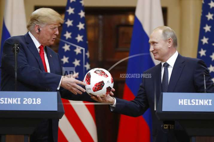 India Tv - Russian President Vladimir Putin gives a soccer ball to US President Donald Trump, left, during a press conference after their meeting at the Presidential Palace in Helsinki, Finland on July 16, 2018. (AP Photo/Alexander Zemlianichenko)