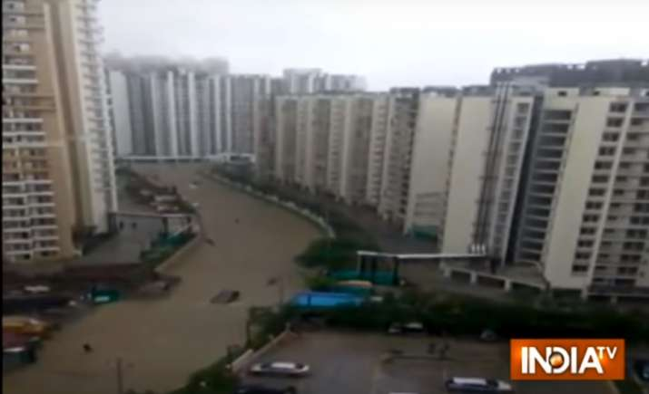 India Tv - Inundated roads in Greater Noid West's posh apartments