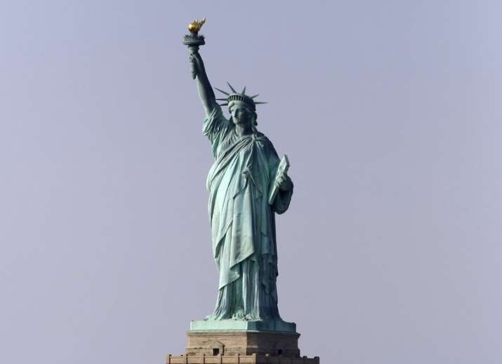 Protester's climb shuts down Statue of Liberty on US