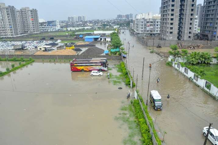A view of a flooded locality after heavy rains, in Surat on