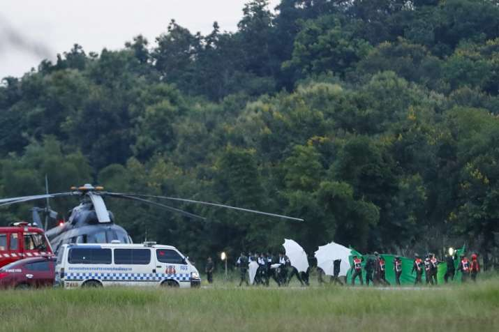 India Tv -  An emergency team rushes to a helicopter believed to be carrying one of the rescued boys from the flooded cave in Mae Sai as divers continue to extract some of the 12 boys and their coach trapped at Tham Luang cave in the Mae Sai district of Chiang Rai province, northern Thailand, Tuesday.