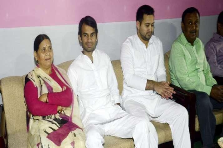 Tej Pratap Yadav (centre) with mothe Rabri Devi and brother