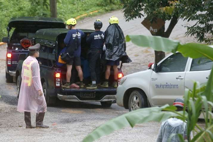 India Tv - Rescuers move to the entrance to a cave complex where five stil lwere trapped in Mae Sai, Chiang Rai province, northern Thailand on Tuesday.