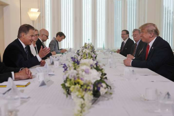 India Tv - Finnish President Sauli Niinisto, left, and US President Donald Trump, right, sit down for a working breakfast at Niinisto's official residence in Helsinki, Finland on Mondayprior to his meeting with Russian President Vladimir Putin in the Finnish capital.