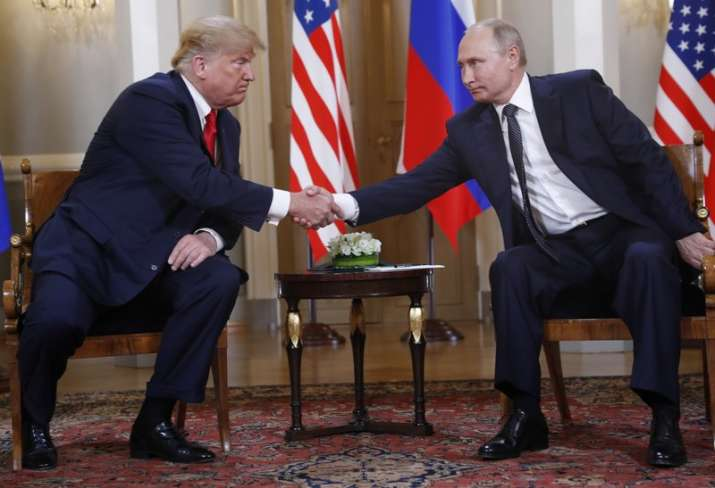 India Tv - Trump initiated a brief handshake with Putin, as the assembled press jostled to capture the moment.