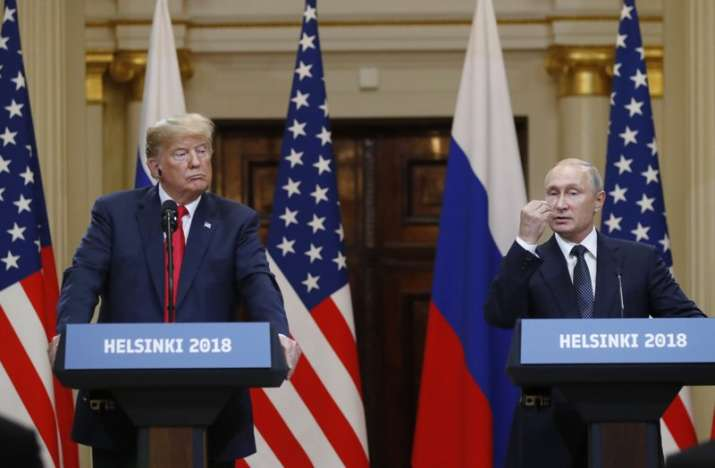 US President Donald Trump, left, listens to Russian
