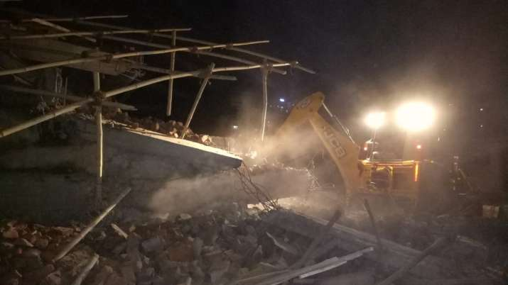 India Tv - Greater Noida: Six-storey building crashes into another in Shah Beri village, at least 50 people feared trapped in debris