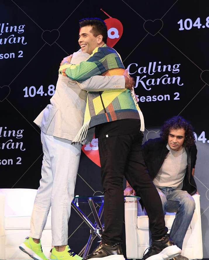 India Tv - Rannvijay Singha and Karan Johar hugging each other at Calling Karan season 2 launch event.