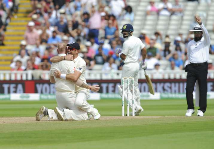 India Tv - Anderson celebrated with Stokes after Kohli's dismissal in Birmingham