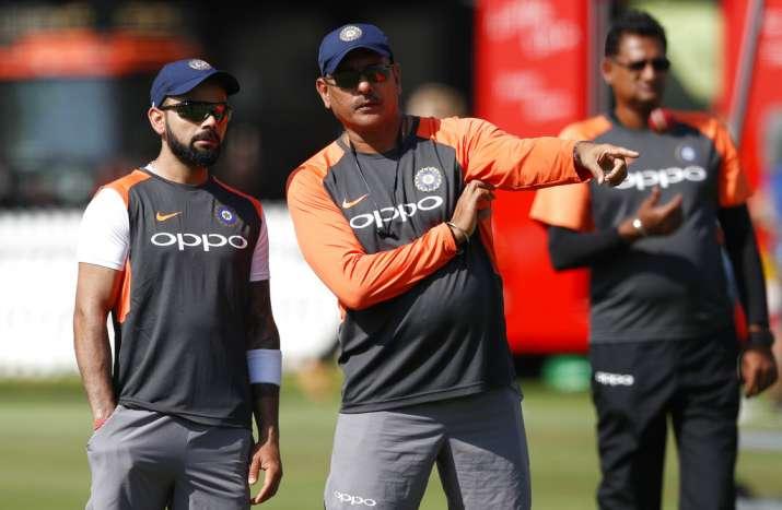 India Tv - Kohli with coach Shastri
