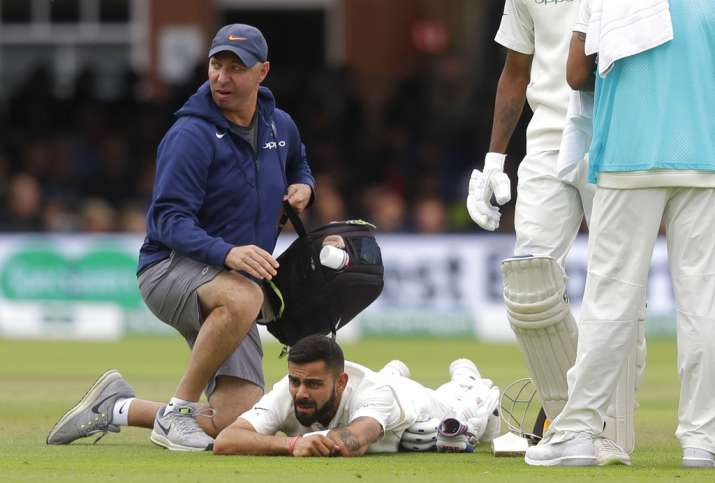 India Tv - Kohli received treatment during the match while batting