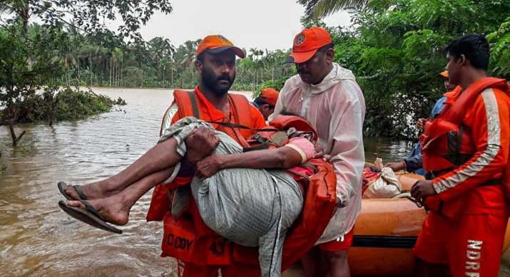 India Tv - Wayanad: NDRF personnel rescue the flood-hit people in Wayanad, Kerala on Saturday, August 11, 2018.