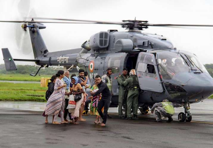 India Tv - Kochi: Air Force personnel carry out rescue operations at a flood-affected region following heavy monsoon rainfall, in Kochi on Thursday, Aug 16, 2018.