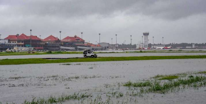 India Tv - Kochi: Submerged area near Cochin International Airport after monsoon rainfall, in Kochi on Wednesday, Aug 15, 2018. The Cochin International Airport at Nedumbassery reportedly suspended operations till Saturday due to rains and floods.