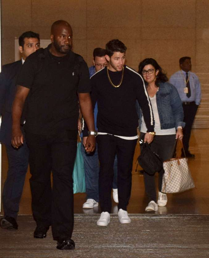 India Tv - Nick Jonas and his parents were seen arriving Mumbai at the airport