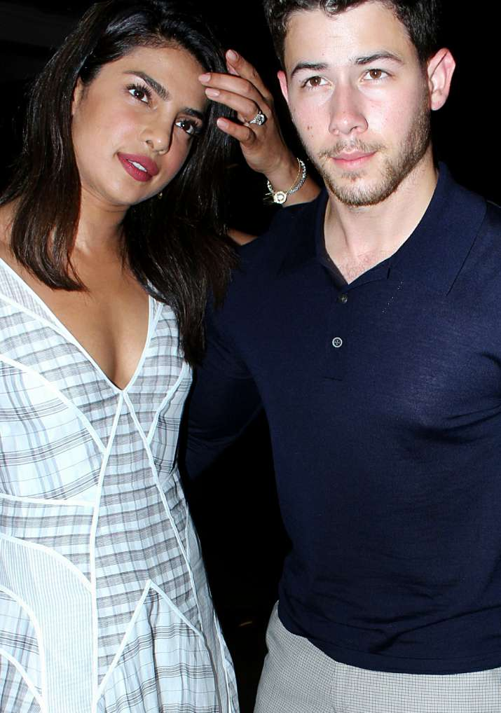 India Tv - Nick Jonas can't stop blushing and smiling.