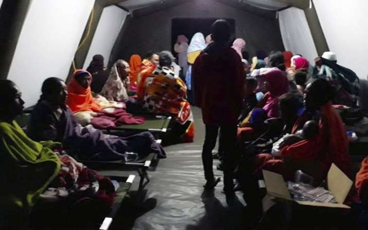 India Tv - People affected by the earthquake rest at a temporary shelter in Lombok, Indonesia