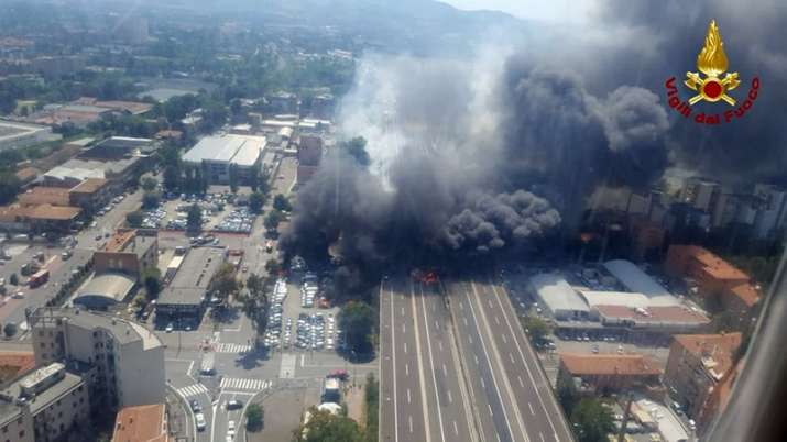 India Tv - In this photo released by the Italian firefighters, an helicopter view of the explosion on a highway in the outskirts of Bologna, Italy, Monday, Aug 6, 2018.