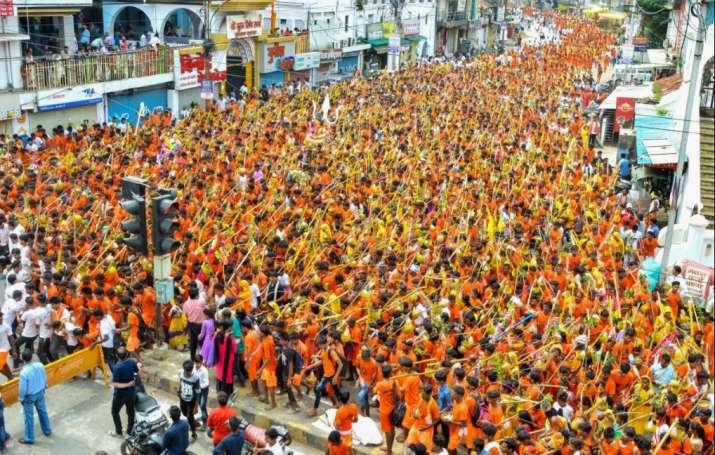 Hindu devotees (Kanwariyas) carry holy water to