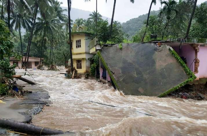 India Tv - Kozhikode: Roof of a house collapses following a flash flood, triggered by heavy rains, at Kodencheri in Kozhikode district of Kerala on Thursday