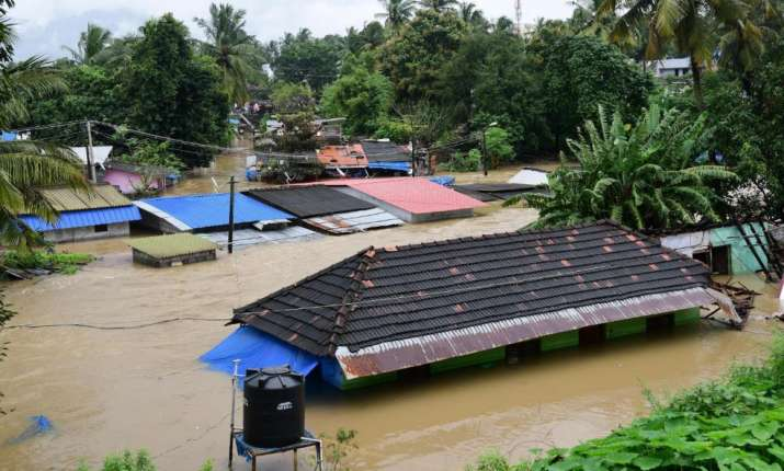 India Tv - Palakkad: A view of houses submerged in water following a flash flood, triggered by heavy rains, at Palakkad in Kerala on Thursday