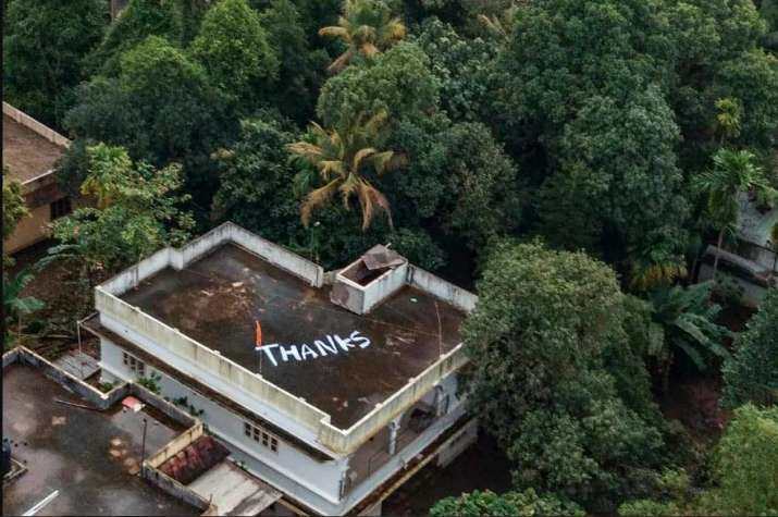 India Tv - Kochi: 'Thanks' is written on the roof of a building to convey Kerala people's gratitude to Indian Navy and Air Force for their rescue and relief operations towards the flood-affected people, at North Paravoor