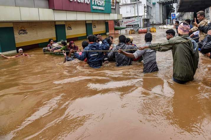 India Tv - People being rescued from a flood-affected region in Kochi. (Photo/PTI)