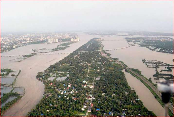 India Tv - An aeriel view of the floods in Aluva after heavy rains, in Kerala on Friday