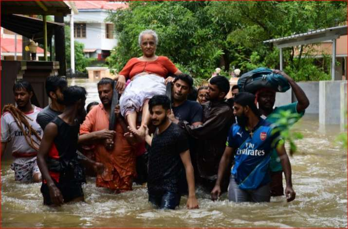 India Tv - An elderly woman is rescued following a flash flood, triggered by heavy rains, at Palakkad in Kerala