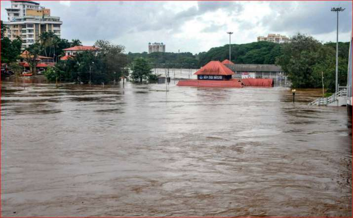 India Tv - Aluva Mahadeva Temple is seen submerged in the water following a flash flood, triggered by heavy rains, at Kochi in Kerala